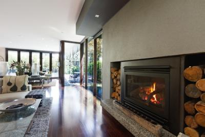contemporary living room with log fire heater