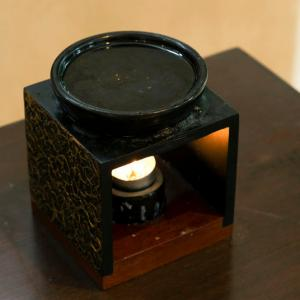 Oil burner on table