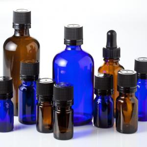 Brown and blue glass essential oil bottles