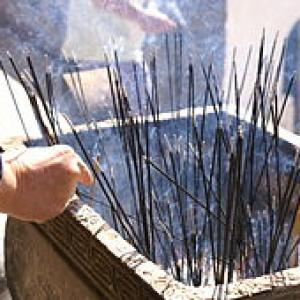 Burning incense sticks at Wutai Shan